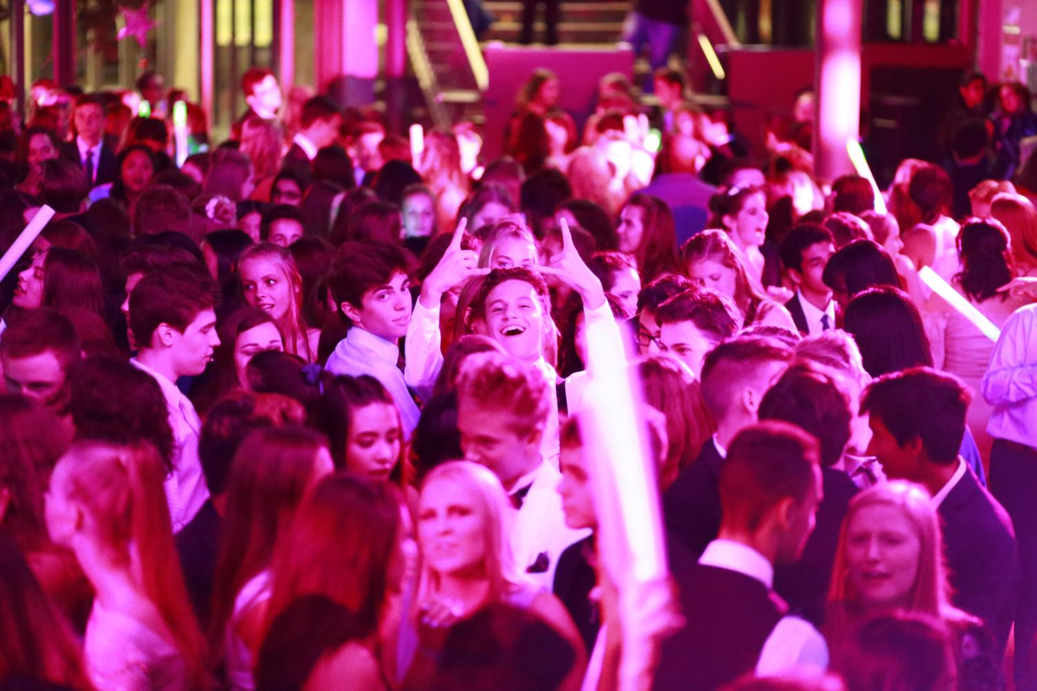 HOMECOMING 2018: Bright lights bathe dancing students in a pink glow at Issaquah High's out of this world homecoming dance.