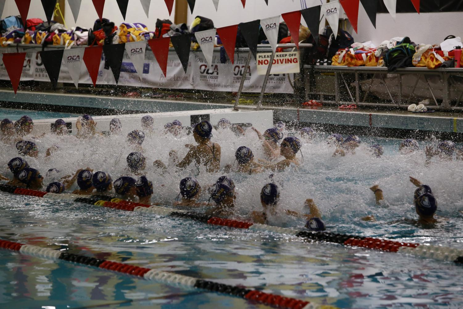 GO ISSAQUAH! The swim team huddles up for a pre-game chant to get all the girls ready to go.