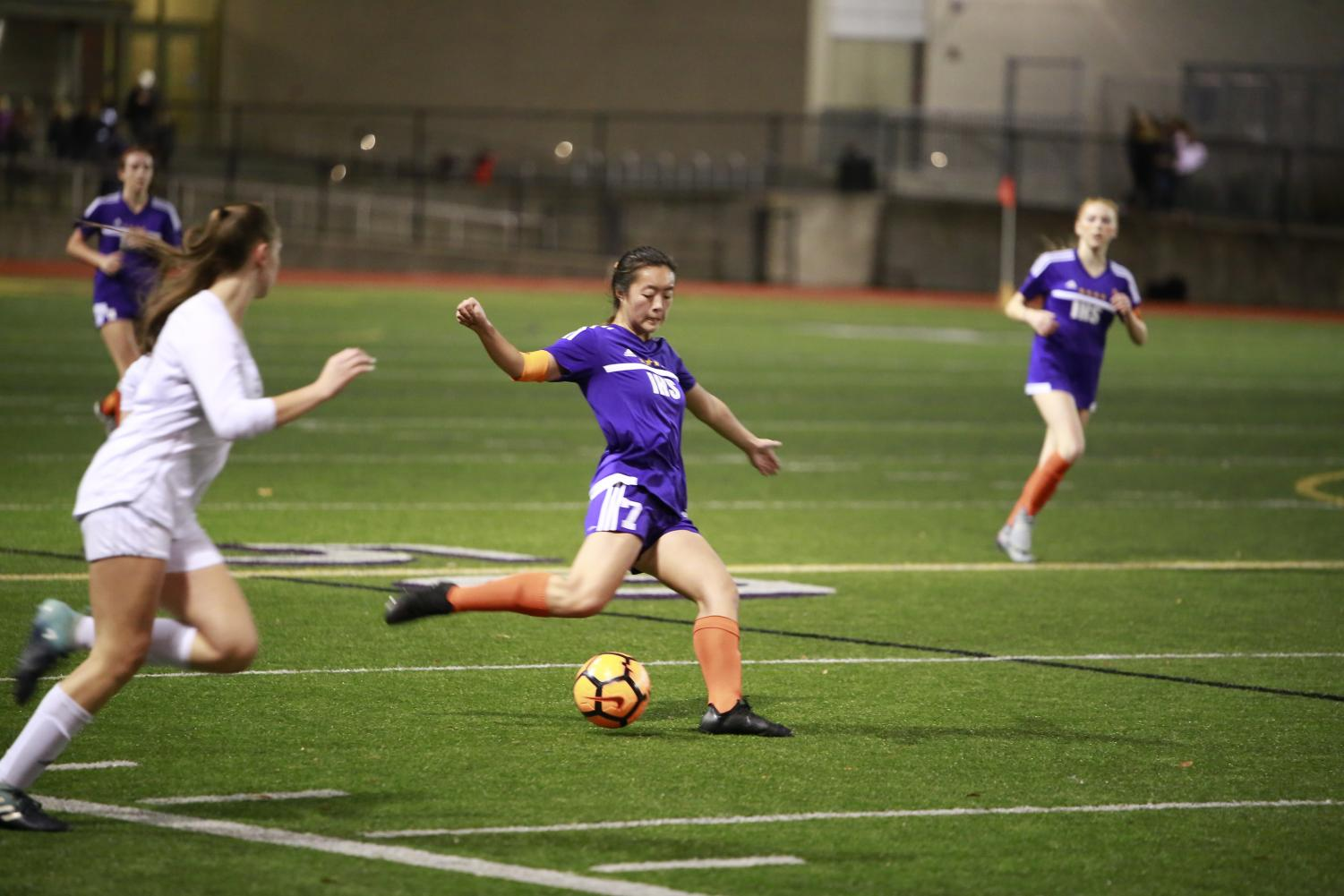 SKILLFUL PLAY: Senior Sarah Kim attacks the ball. The Issaquah Girls' Varsity Soccer Team keeps the ball close to the ground, plays aggressively, and works well as a unit.