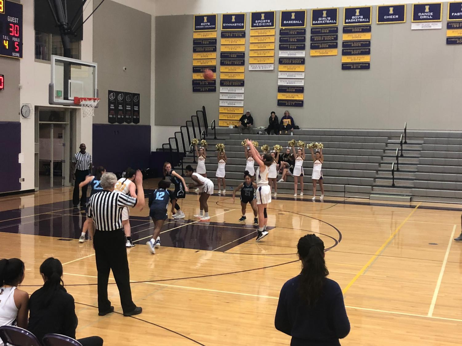 VICTORIOUS: The Issaquah High School Junior Varsity Girls' basketball team won a hard-fought game against the Meadowdale Mavericks last Saturday night.
