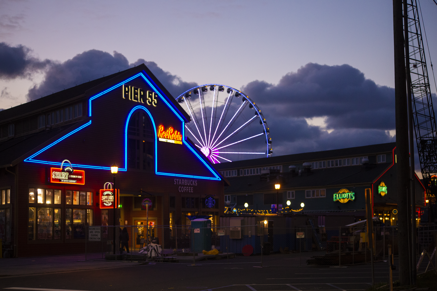 NIGHT AT PIER 55: Pier 55 is one of the many popular destinations in Seattle and is home to restaurants, the Seattle Great Wheel, and the Seattle aquarium.