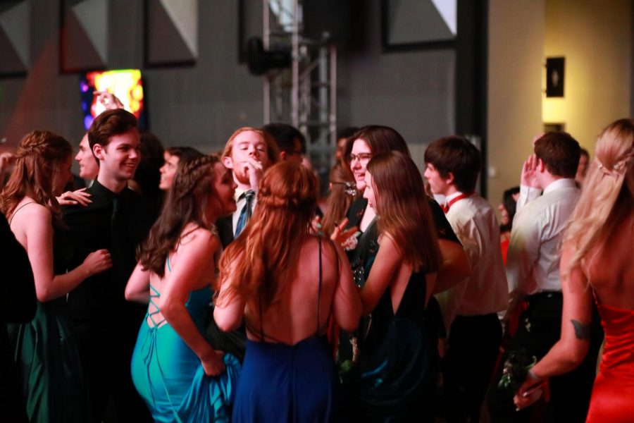 DRESSED+TO+SHINE.+This+year%E2%80%99s+prom+theme+of+Hollywood+brought+the+most+glamourous+suits%2C+dresses%2C+rompers%2C+and+shoes+to+the+dancefloor.+Students+showcased+their+personalities+through+their+outfits+making+for+diverse+fashion+and+beautiful+styles.