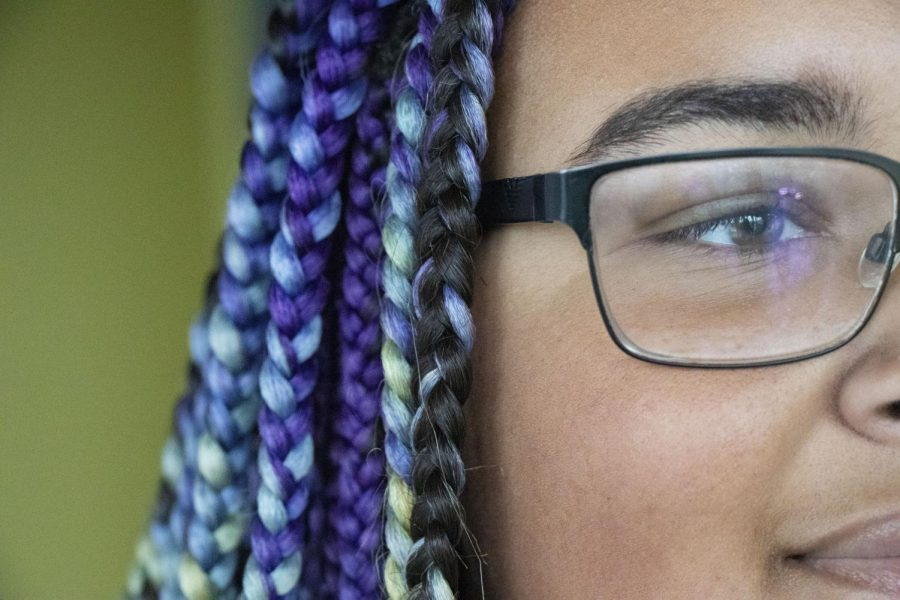 COLORFUL+AND+CONFIDENT+Sophomore+Desitiny+Callendar+shows+her+personal+style+with+colorful+braids.+Teens+at+Issaquah+expressed+their+opinions+about+school+dress+code+versus+free+dress%2C+and+share+their+feelings+about+the+use+of+school+uniforms.+