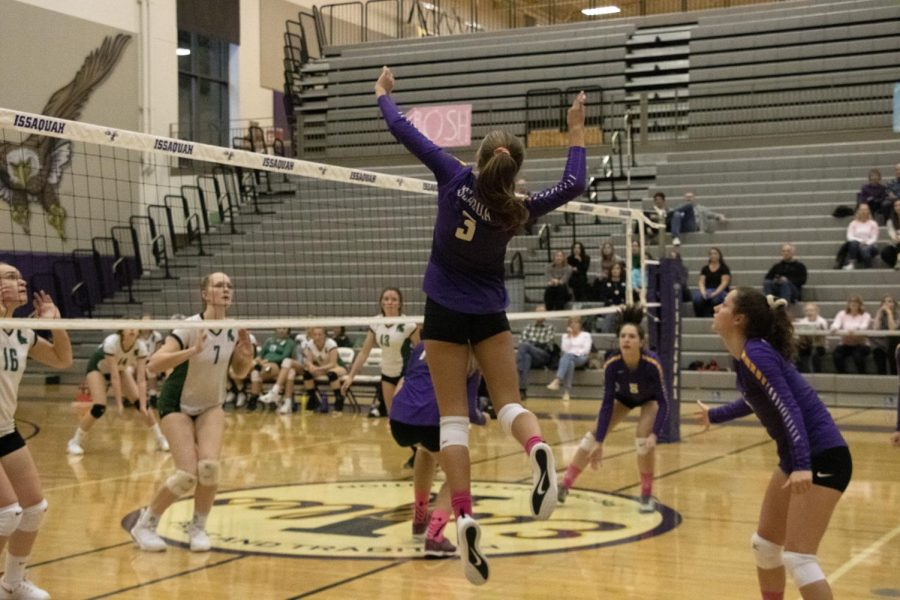 UNDEFEATED AND DETERMINED Freshman Ella Wimmer flys through the air smacking the ball over the net scoring another point for Issaquah Girls' Junior Varsity Volleyball Team.