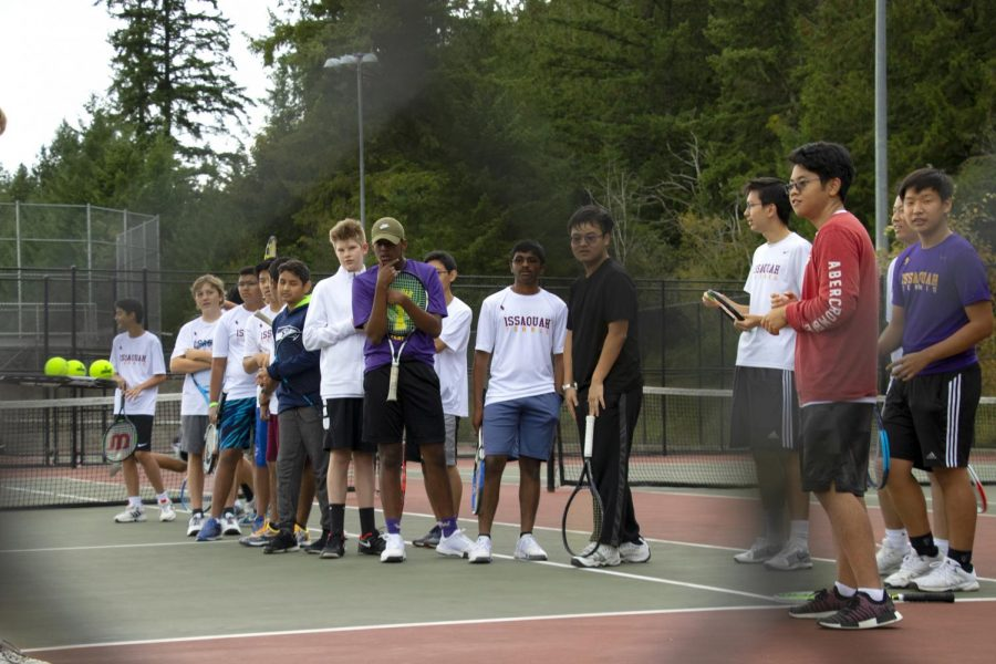 HOPING FOR A MATCH Issaquah JV boy's tennis lines up for introductions against Inglemoor.