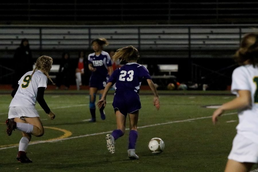 PHENOMENAL PASSING Issaquah midfielder (23) sizes up a pass to a teammate with a Redmond defender (9) in close pursuit. Issaquah's passing was far superior to Redmond's for large portions of the game.