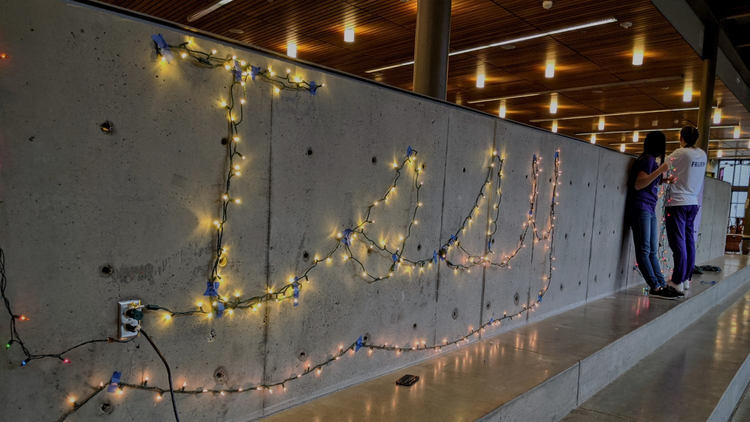 """HOLIDAY SPIRIT: During """"Deck the Halls,"""" ASB spells """"Issy"""" with a string of lights in the commons."""