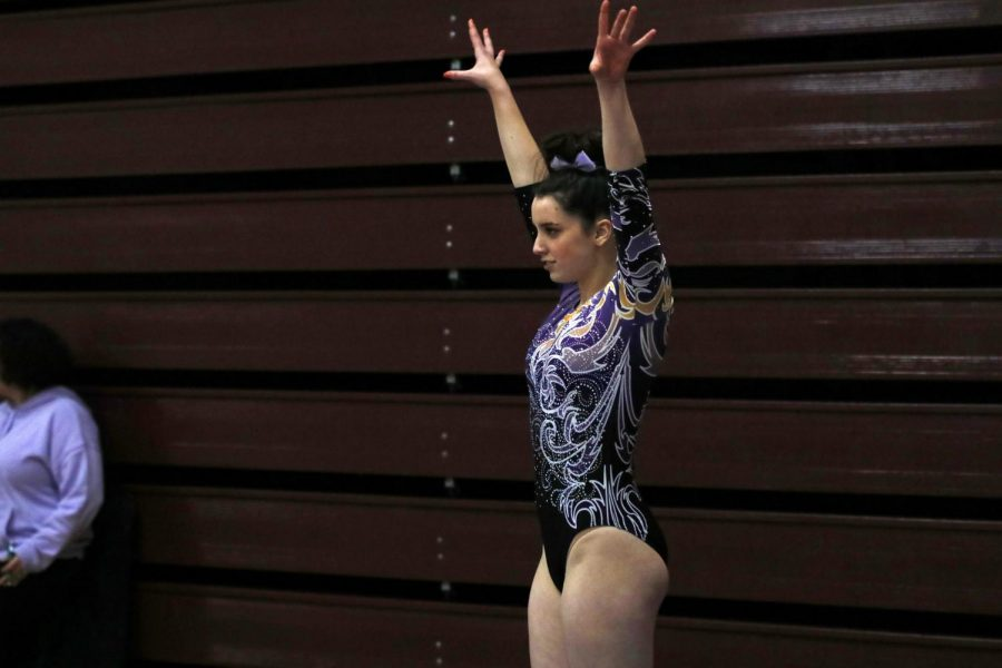 ON THEIR WAY TO VICTORY Issaquah Girls' Gymnastics places second in their very first meet of the season. Pictured is Hannah Munson, one of the very talented gymnasts on the team.