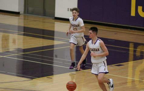 SEASON OPENER Sophomore guard, Mason Muir, pushes the ball up the court for the high-powered Issaquah offense.