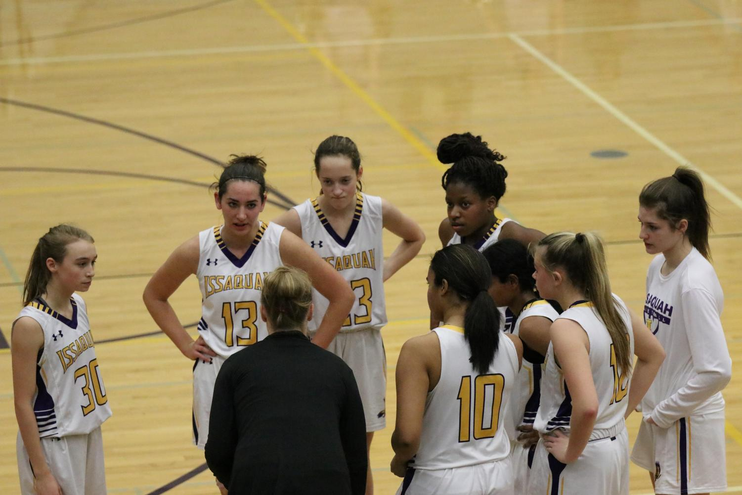 FOCUSED ON THE WIN: The Issaquah girls huddle together to ensure they hold on to their lead to win the game.
